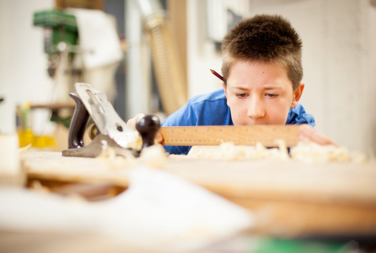Boy in woodwork class
